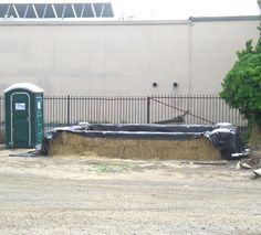 Hay bale pool...minus the port-a-potty