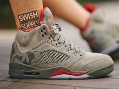The latest images of the Air Jordan 5 Camo show what the shoe look like on- feet. 5c3f45646