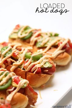 Loaded Hot Dogs! No better way to enjoy a summer BBQ than hot dogs on the grill loaded up with toppings.