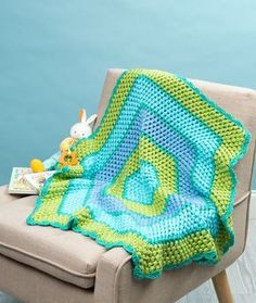 Beach Time Hexagon Blanket Free Crochet Pattern in Red Heart Yarns - Start at the center and crochet six-sided rounds for this easy hexagon blanket. Whether for beach time or overnights at grandma's, it will offer comfort to a precious baby or child.
