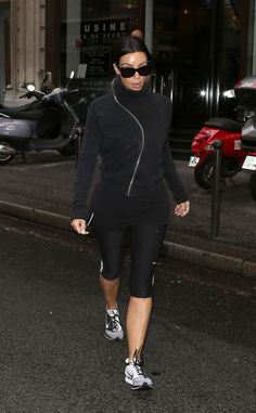 Kim walks post-workout from L'Usine gym in Paris on May 21, 2014.
