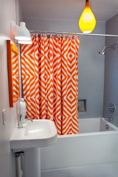 gray and orange shower curtain. grey bathroom with statement shower curtain Master inspiration  Love the chevron