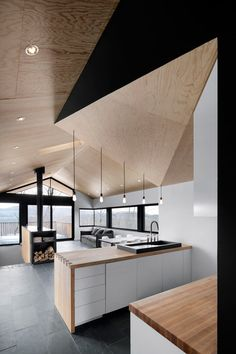 Minimalist Kitchen // geometric wood ceiling and counter tops in this clean modern kitchen designed by naturehumaine. The Bolton Residence, a house on a sloped site surrounded by woodlands in Quebec, Canada. Interior Exterior, Interior Design Kitchen, Modern Interior Design, Design Interiors, Kitchen Decor, Contemporary Design, Kitchen Pantry, Kitchen Ideas, Interior Decorating