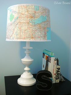 Map covered lampshade with a spray painted lamp that used to be ugly brass.