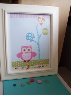 Wall decor with scrapbook scraps.  I want to re-create this.  Just another reason why I need a Cricut machine.  :)  Would be so cute for a baby's room, too.  Maybe for after my cousin has her IVF if she has a baby girl.