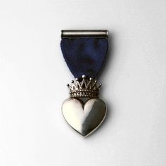 Conqueror Medal cast in sterling silver by Love Medals