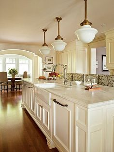 Traditional White Kitchen; love the cabinets and the light fixtures.  Also the arched doorway