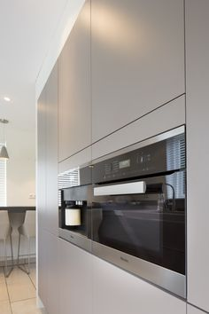 Contemporary KitchensModern KitchensBlack KitchensKitchen  ModernContemporary DesignKitchen BlackWalnut KitchenGalley KitchensModern  Design