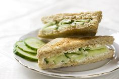 The perfect sandwich for afternoon tea. Cucumber Sandwiches Submitted by: LucyInTheSkye I loved these when I was little! Sandwiches Afternoon Tea, Cucumber Tea Sandwiches, Wrap Recipes, Milk Recipes, Yummy Recipes, Recipies, Healthy Recipes, Healthy Potluck, Dinner Healthy