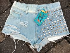 Upcycled jeans shorts by 16-year old designer Sophia Scanlan for Stubborn Jeans. Ripped with super-studs on one side.