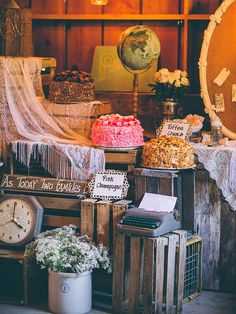 Build vintage wedding vibes with an antique DIY wooden crate dessert table -- play with different levels for a fully stocked presentation.