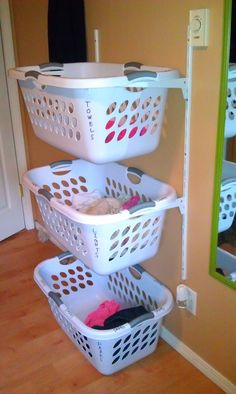 An easier and cheaper alternative to the laundry basket dresser thats been going around pinterest-- just install shelving hardware and slide your baskets on!