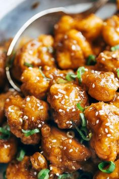 General Tso's Cauliflower - golden brown crispy fried cauliflower tossed in a made-from-scratch spicy sweet sauce. Awesome vegetarian / meatless recipe.