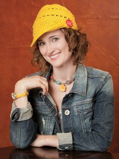 Hip crochet hat with a button in yellow.  What color would you choose?