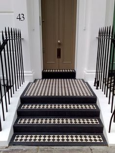 Love these Victorian style tiles leading up to front door