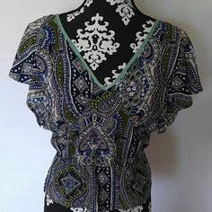 """Anthropologie Postella flutter sleeve top Anthropologie Postella blouse. Short flutter type sleeves. V neck. Keyhole in back with tie. Cinched peplum style waist. Beautiful multi color print. 100% silk. Size small. Worn once or twice EUC.  Measurements laying flat: Shoulder to shoulder: 17.5"""" Underarm to underarm: 17.5"""" Length: 23"""" Anthropologie Tops"""