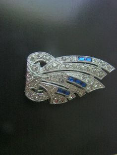 JoysShop is pleased to present for consideration this wonderful antique Art Deco dress or fur clip, featuring a combination of clear chatons and sapphire blue baguette rhin... #teamlove #voguet #vjse2
