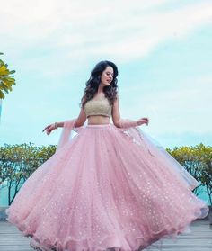 Is a pink lehenga what you always dreamt yourself getting married in? We are here with some spectacular images of 'Pink' brides who looked like royalty on different wedding occasions. Call/Whatsapp us on : Indian Wedding Gowns, Party Wear Indian Dresses, Designer Party Wear Dresses, Party Wear Lehenga, Indian Gowns Dresses, Dress Indian Style, Indian Fashion Dresses, Indian Designer Outfits, Colorful Prom Dresses