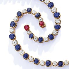PROPERTY FROM THE COLLECTION OF MRS PAUL 'BUNNY' MELLON: A Gold, Sapphire, Diamond and Ruby Bracelet, the line bracelet set with 10 oval and cushion-cut sapphires weighing 19.94 carats, spaced by round diamonds ~ 7 carats, the clasp further set with a cushion-cut ruby weighing 1.47 carats.