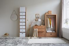 cardboard furniture from Berlin for your clothing - wardrobe and chest of drawers are all paper and can be uses as all other pieces of furniture