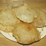 Deep fried Indian flatbread.1 cup whole wheat flour 1 tsp ajwain (carom seeds) 1 tsp salt ½ cup warm water for kneading Oil for deep frying