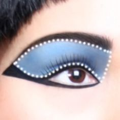 Cleopatra Eye Shadow Step 5: Cleopatra Eye Shadow  For this look, we will only be using one blue eye shadow. You want a true blue, Starting at the lash line, apply your eye shadow and work your way to the crease and up to the brow bone. Be sure to cover the entire eye area.
