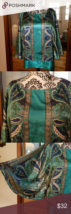 Lane Bryant blouse EUC. Beautiful Lane Bryant butterfly sleeve blouse. This top is gorgeous! Teal, purple, white, cream, blue and black shining on this shimmery fabric with a paisley pattern. The bottom hem is a band of teal with a tie at the left hip. Would look fantastic with a pair of black palazzo pants for a night out. Or a pair of white capris. Size 18/20. Lane Bryant Tops Blouses