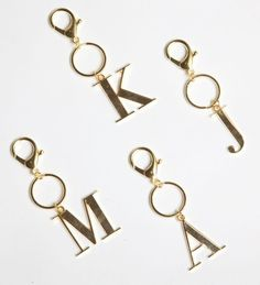 "Description: Personalize your Keys with our chic Gold Initial Keychain. (S,B,T,M,A,C,K,J,H,R,L,E) Designed in USA/imported 2"" x 3.75"" Plated Alloy"