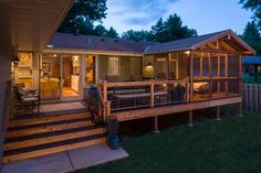 I like the interesting use of a deck extending from the screened porch. Building Arts Sustainable Architecture