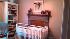 Neutral Baby Boy Nursery with Mantel and Deer Mount - #babyboy #nursery