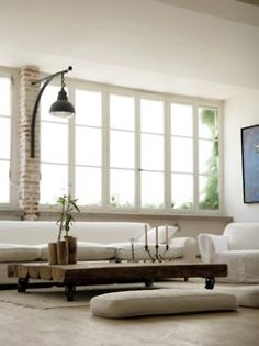 Simple sophisticated yet rustic living room.  #bohemian #decor #white
