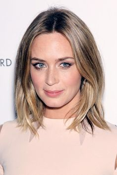 Emily Blunt looks sleek and chic with loose blond waves – Hair Do's & Don'ts brought to you by Glamour.com. Visit Glamour.com for the latest dos and don'ts for hairstyles, with celebrity photos.