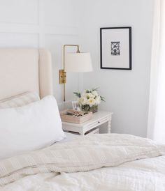 Wall, sconce lighting, bed, table