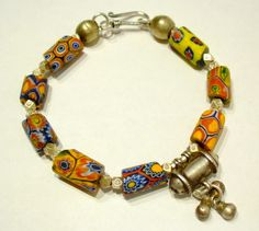 by Eva Manning | Bracelet combining antique millefiore trade beads from the West African trade, new Hill tribe silver beads and a silver pendant from Rajasthan | 350$