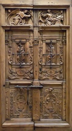 Pair of Doors showing the Annunciation and Instruments of the Passion Spain 1550-1600 CE Walnut with iron mounts