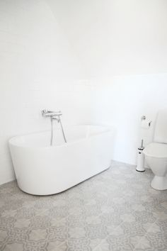 Idea- if you want all of your bathroom items such as a toilet and tub to see to disappear here is the perfect example. While the tub seems to disappear into the walls all of the attention is of course on the tiled floor.