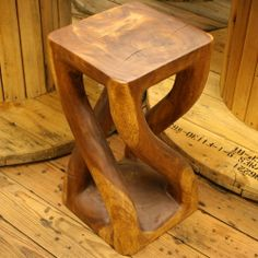 Great Father's Day gift! Fair Trade Wooden Vine Stool/Side Table — Handmade in Thailand — from Fair & Square Imports — This hand-carved piece could be used as a stool or side table. Handmade with Monkey Pod wood (or Rain Tree wood; Samanea saman) by rice farmers during the off-season. #fathersday