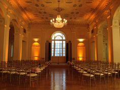 Beautiful amber gold up lighting for a romantic Ceremony by Fonix Entertainment! #ceremony #uplighting #djservices #fonixentertainment #biltmoreballrooms