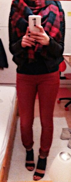 Red jeans, black leather jacket, two sided plaid scarf and a black heels.
