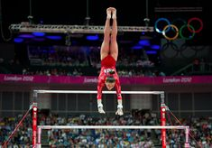 Kyla Ross on the uneven bars