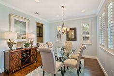Traditional Dining Room with Interior plantation shutters, Carpet, Pendant light, Hardwood floors