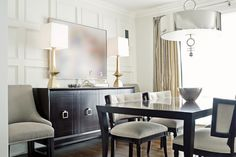 Mixing soft BRASS and polished NICKEL enhances the monochromatic colour scheme in this Dining Room.