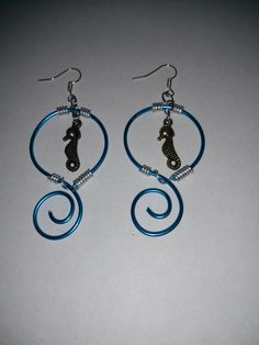 Sea horse earrings by IntrigueByTania on Etsy