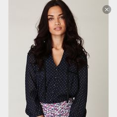 New Free People Black Trimmed Polka Dot Blouse New, never worn, Free People black trimmed polka dot blouse in navy size medium. Blouse is intended to fit loose. Made of 65% rayon and 35% cotton. Free People Tops Blouses