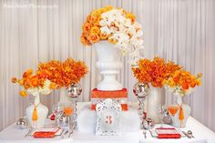 orange flowers. love this but would definitely go with a little more rustic feel