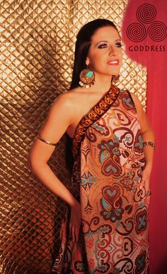 Love the gorgeous patterning and use of turquoise in this goddess gown.