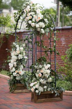 Classic garden wedding arch: http://www.stylemepretty.com/north-carolina-weddings/wilmington-nc/2015/10/02/classic-black-tie-north-carolina-coast-wedding/ | Photography: Theo Milo - http://theomilophotography.com/
