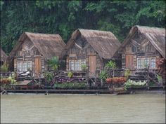 Cottages floating on the water.    Kanchanaburi, Thailand