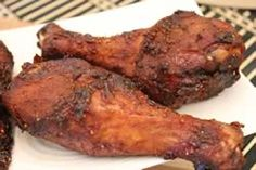 smoked chicken legs and thighs in a bradley smoker with complete step by step instructions for preparing and smoking them to perfection.