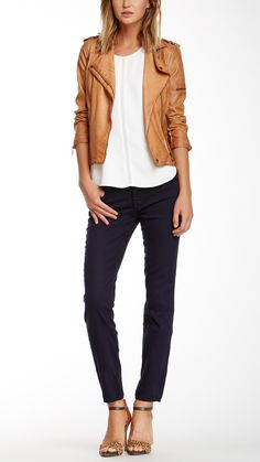 Skinny jeans always pair well with strappy heels & a simple leather jacket.